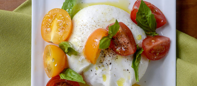 Mozzarella with fresh tomatoes and basil for healthy meals