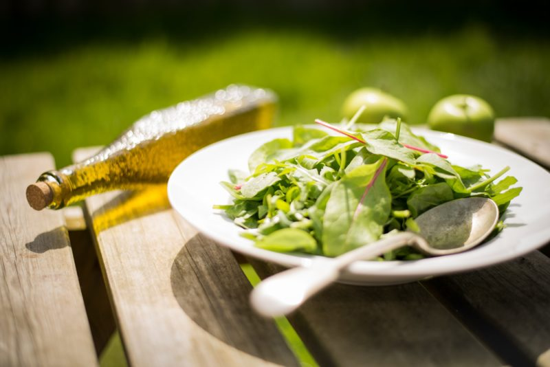 Healthy meals and fresh salad on outdoor table